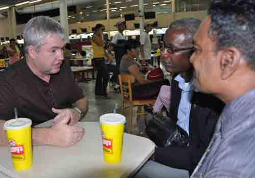 Phil Whipple, US Bishop, talks to Jamaican delegates Isaac Nugent and Winston Smith at the San Pedro Sula, Honduras, airport