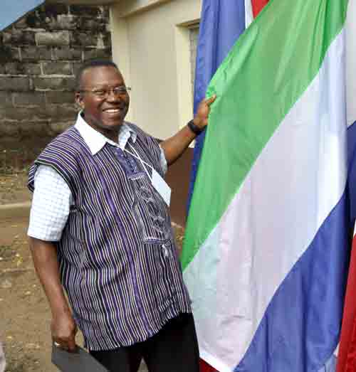 Billy Simbo (with the Sierra Leonean flag) reported on the work in Sierra Leone.