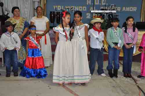 Children clad in outfits for each country represented sang the national anthem for that country.,
