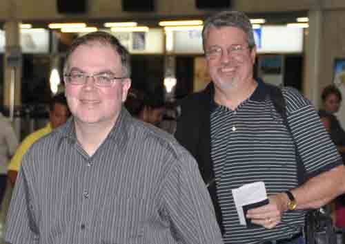Canadians Paul Plato (left) and Brian Magnus finally arrive in San Pedro sula after a flight delay in Miami.