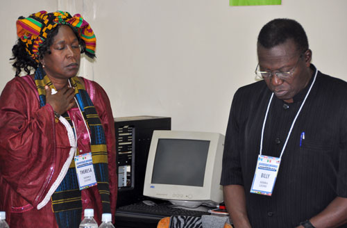 Theresa Musa and Billy Simbo (Sierra Leone) during the prayer time for Haiti. Billy also opened with the day's devotional.