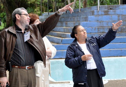 Juanita Chavez, superintendent of Honduras Conference (right) points out some features to Denis Casco (Mexico) and Donna Hollopeter.