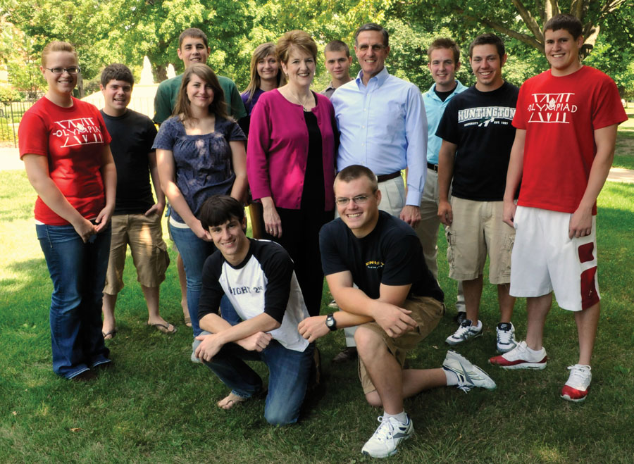 Blair and Chris Dowden with Huntington University students.