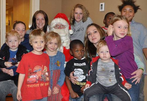 Residents of Charis House with Santa (Anchor's own Tim Bauman)