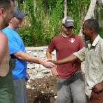 Andy Sikora greeting the pastor of the church at Kiloma.