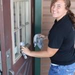 Cleaning a door as part of the 2012 HU Volunteer Plunge