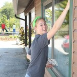 A new student cleaning windows as part of the 2012 HU Volunteer Plunge