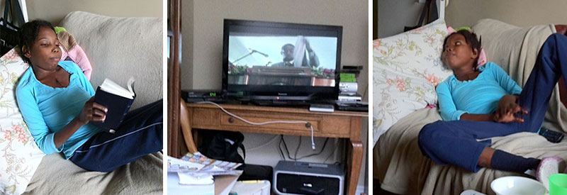 Hermmy watched a DVD of the August convention at the Delmas 33 church in Haiti. She sang along and (right) looked at a French Bible as a speaker addressed the crowd. (click to enlarge)