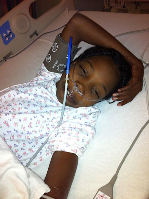 A smile for Mommy Joan as Hermmy is prepped for surgery on October 10.