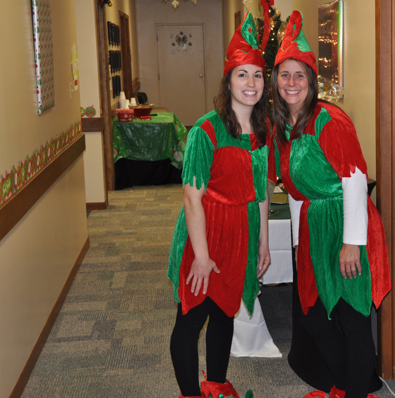 Kristi Welker, online admissions counselor, and Tanya Horvath, admissions counselor for professional programs, are among the elves.