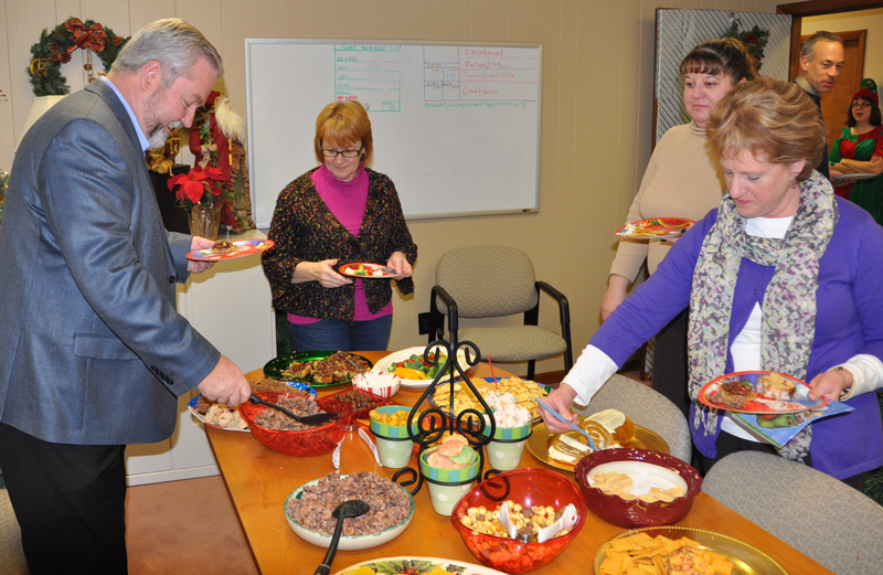 The Healthy Ministry Resources staff takes it turn at the sweets table. L-r: Bishop Phil Whipple, administrative assistant Cathy Reich, Finance Director Marci Hammel, and Global Ministries administrative assistant Peggy Sell.