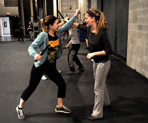 Students in the J-Term class on stage combat.