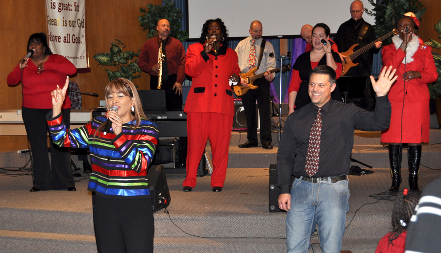 Pastor Tim Hallman of Anchor (right) and Dr. Crystal Bush, pastor of New Zion Tabernacle (left), with the combined worship team behind them.