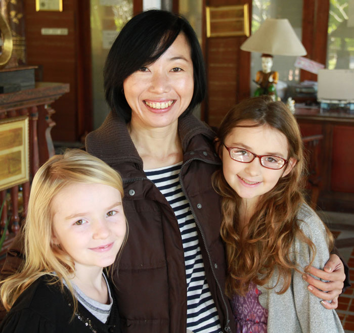 A Thai childcare worker with Karis and Ellie Dice.