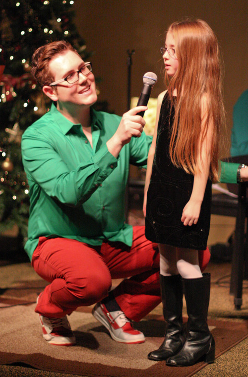 Josh Greenfield with a young participant in the Christmas Bash.