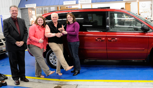 """L-r: Pete Schownir, HU director of gift planning; Mindi Ahl, 2007 alum and business manager at Tom Ahl Chrysler, Dodge, Jeep in Lima, Ohio; Tom Ahl, owner of Tom Ahl dealership; and Grace McBrayer, director of volunteer service and outreach ministry. (With their """"knock your socks off"""" deal)"""