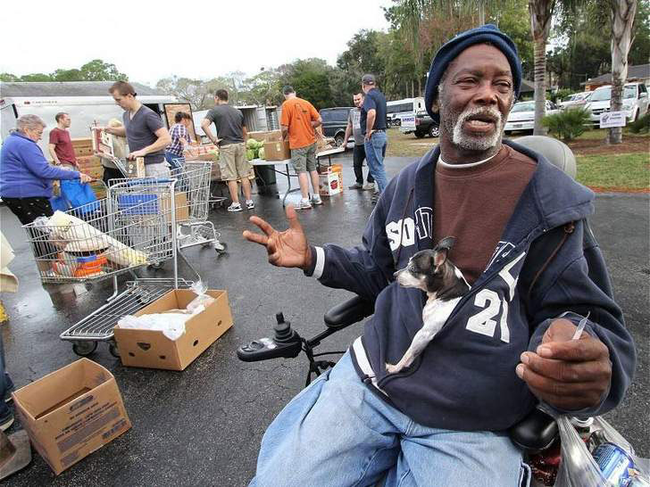 James Maddox waits outside the United Brethren In Christ Church in Holly Hill where food was being distributed to the needy Tuesday morning, January 8, 2012. (Photo by Jim Tiller for the Daytona Beach News-Journal)