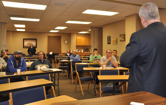 Bishop Whipple speaking to the class.