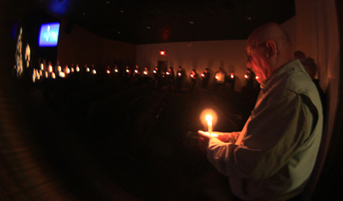 The concluding candle-lighting service.
