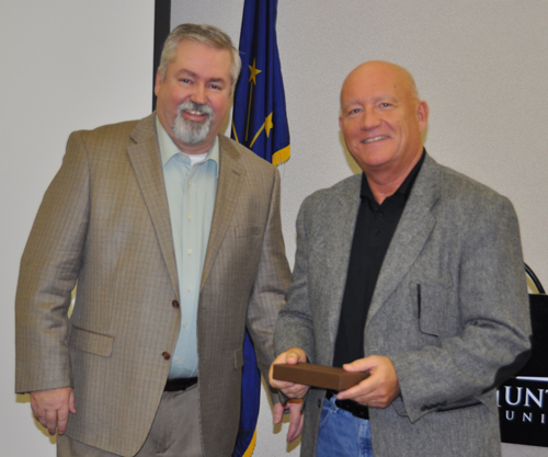 Bishop Phil Whipple (left) presenting a gift to Dennis Miller for his leadership of the clusters since 2009.