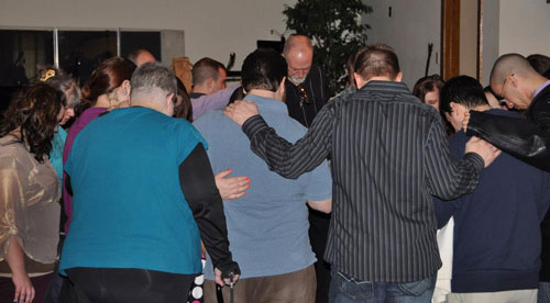 A prayer time after the service was held for the teens and adults who would be attending the Acquire the Fire conference the following weekend.