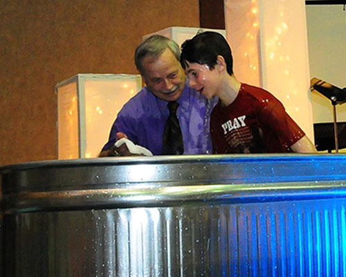 Pastor Les Smith conducting one of the 15 baptisms at Hillsdale UB on Easter Sunday.