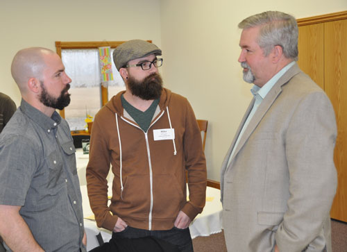 Bishop Phil Whipple (right) with his sons Josh (left) and Mike, both of whom are on staff at Colwood UB church (Caro, Mich.).