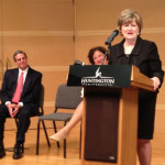 Dr. Emberton speaking at the press conference, as Dr. G. Blair Dowden and HU Board of Trustees chair Shelly Savage listen.