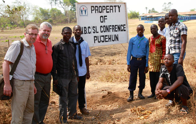 Jeff Bleijerveld (left) and Bishop Phil Whipple (second from left) with Sierra Leone leaders and workers.