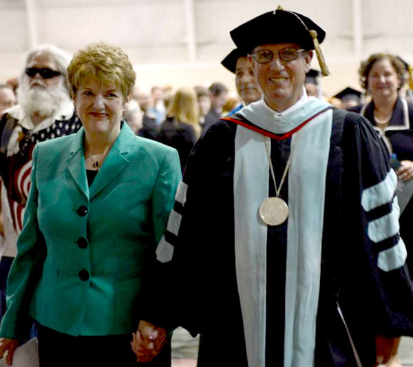 Dr. G. Blair and Chris Dowden walking in their final Huntington University Commencement on May 18, 2013.