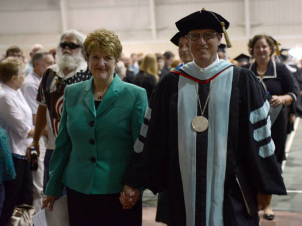 Dr. G. Blair Dowden and wife Chris walking in their last HU Commencement.