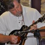 Neil Cudney, co-pastor of Mill Crossing, on the mandolin.