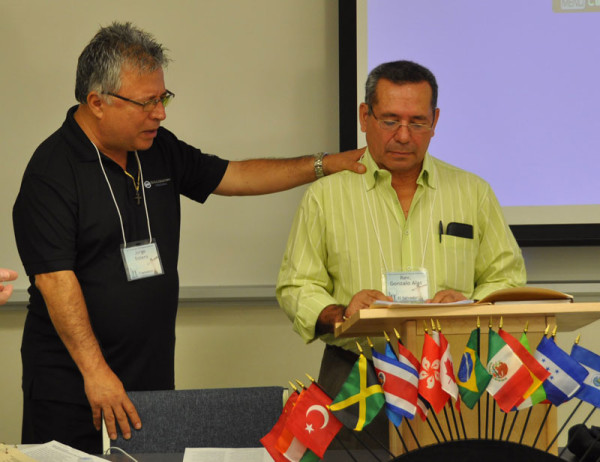 Interpreter Jorge Botero (left) and Gonzalo Alas, superintendent of the work in El Salvador, during the prayer for the El Salvador churches.