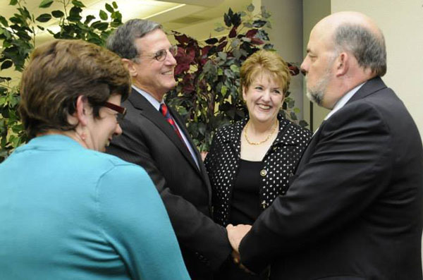 The Dowdens talking to Brooks Fetters, mayor of Huntington, during a May 21 reception.