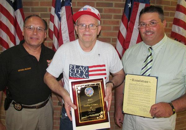 L-r: Hancock County Sheriff Mike Heldman, Jim Woodward, and jail administrator Ryan Kidwell.