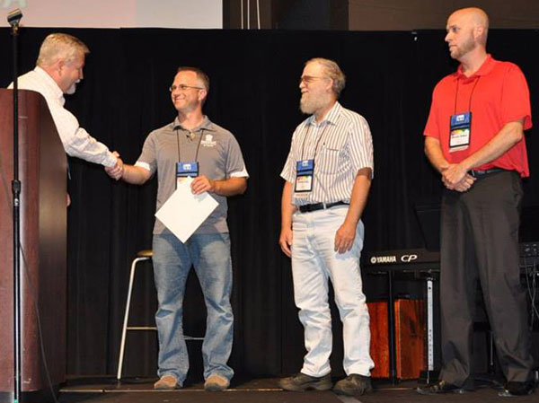 National Conference license recipients. L-r: Bishop Phil Whipple, Chris Kuntz, Elmer Long, and Kendall Sheen.