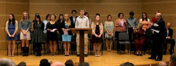 Dr. Paul Michelson (right), professor of History at Huntington University, with the new Alpha Chi inductees.
