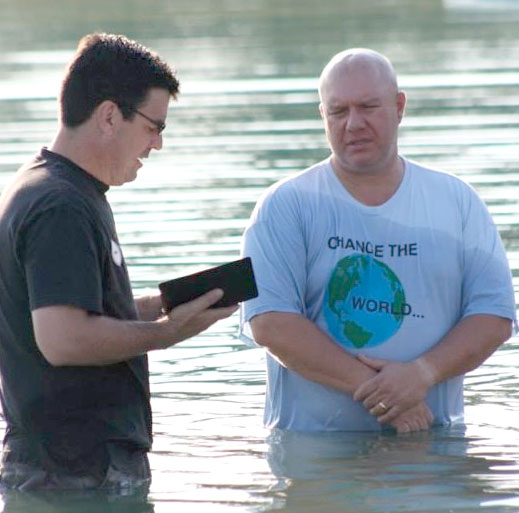 Bridge Fellowship held its first baptismal service in August. Pastor Mike Soltis is on the left.