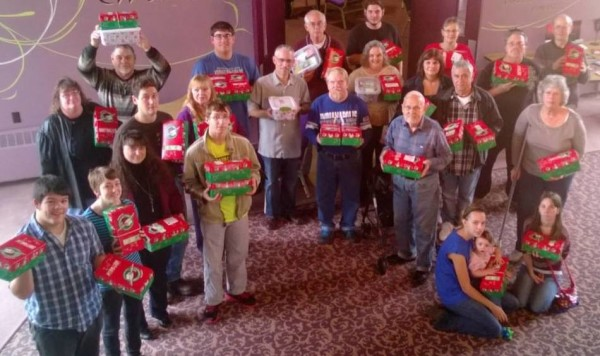 Eagle Quest members with Operation Christmas Child shoeboxes. (click to enlarge)