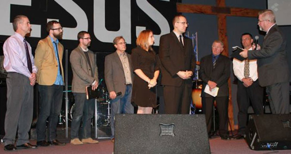 Bishop Phil Whipple (far right) conducting the ordination service.