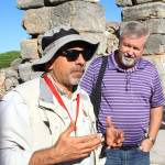 Bishop Phil Whipple (right) listening to Macit, the guide.