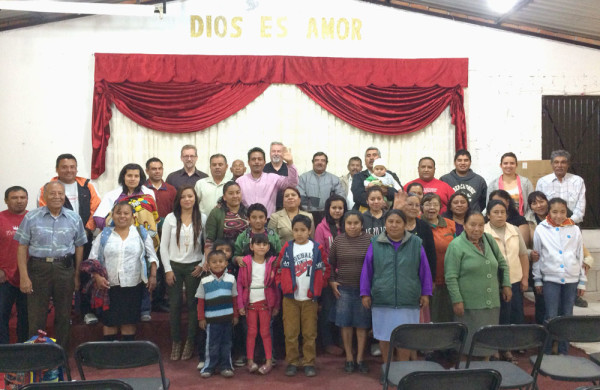 With the Rosa de Sharon congregation in Jesus Maria, Mexico. Bishop Phil Whipple is in the back (with someone's hand partly over his face), and Jeff Bleijerveld is on the left side of the photo.