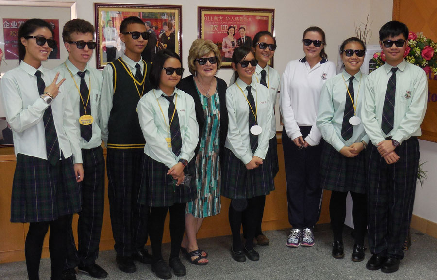 Dr. Emberton with student ambassadors at China Hong Kong English School posing with their cool Huntington University sunglasses.