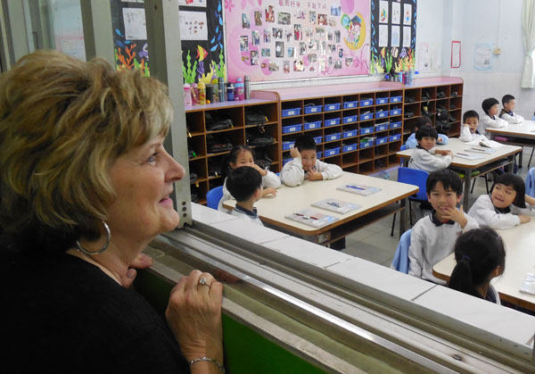 Dr. Emberton looks in on students at China Hong Kong English School in Jiangmen.