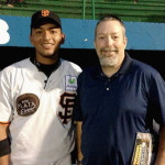 Jeff Dice with Jason Palacios, one of the professional players on the San Fernando team.