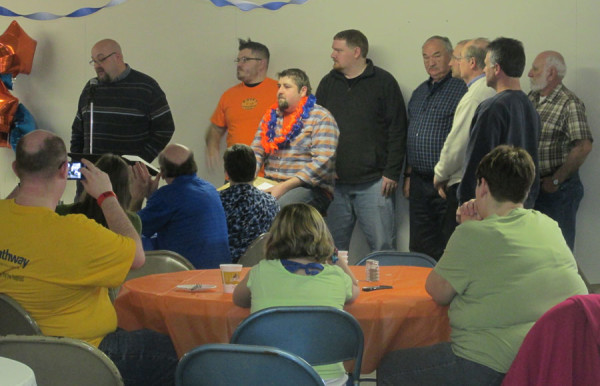 Brent Liechty (left) speaking as other gather around Scott Hardaway.