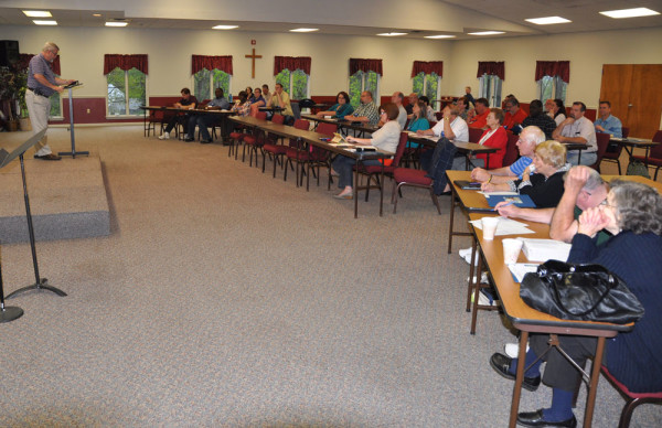Bishop Phil Whipple speaking to the group on Monday night.