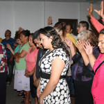 The congregation in prayer on Wednesday night at El Sembrador.