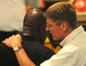 Art Page, senior pastor of Salem UB church, with Pastor Lascase. (Photo by Ryan Blackwell - Public Opinion)