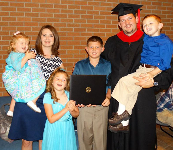 Ricky and Jami Hull and children on graduation day at Winebrenner Seminary.